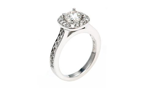 White gold engagement ring with diamond in halo