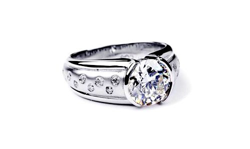 wedding ring with a semi bezel set diamond in white gold with flush set diamond in balance of ring