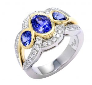 three sapphires and pave diamond outer rows wedding ring