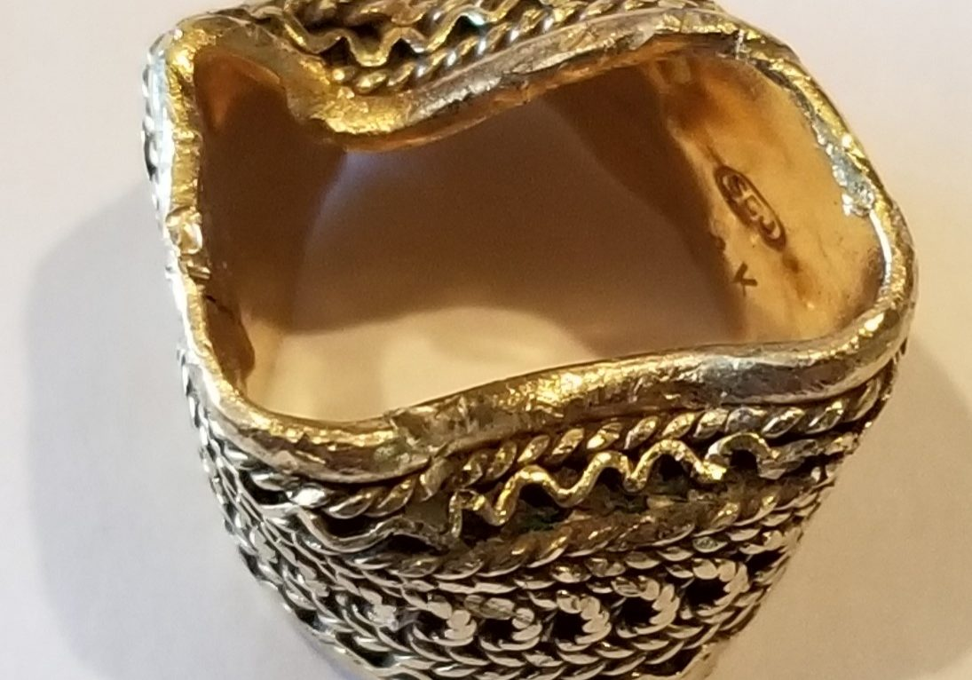 Yellow gold wide ring with damage from garbage disposal