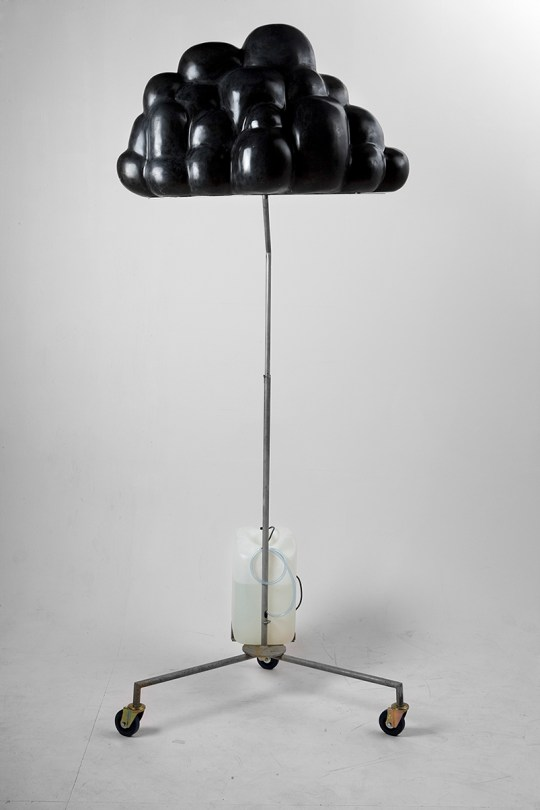 A black cloud on a metal stand. Sculpture.