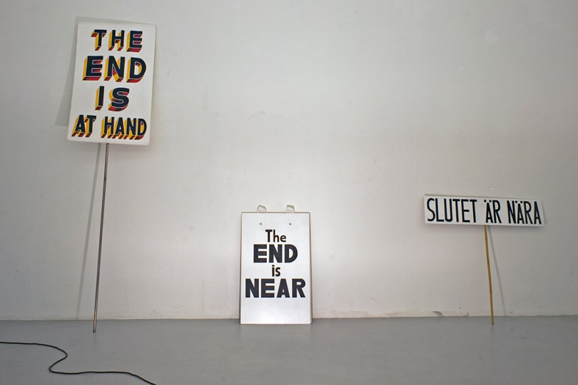"""Signs of disaster - three different signs. """"The end is at hand"""", """"the end is near"""" and """"slutet är nära""""."""