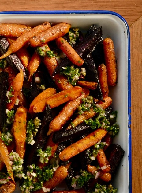 Roasted purpled and orange carrots with salsa verde dressing