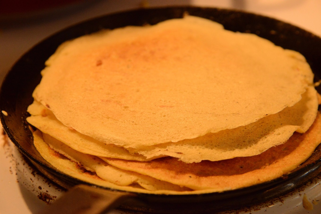 Stack of plant-based crêpes on a crêpe pan