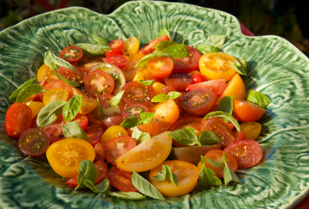 Cabbage ceramic dish with a salad of heritage tomatoes and basil