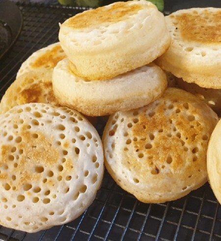 a pile of fresh crumpets