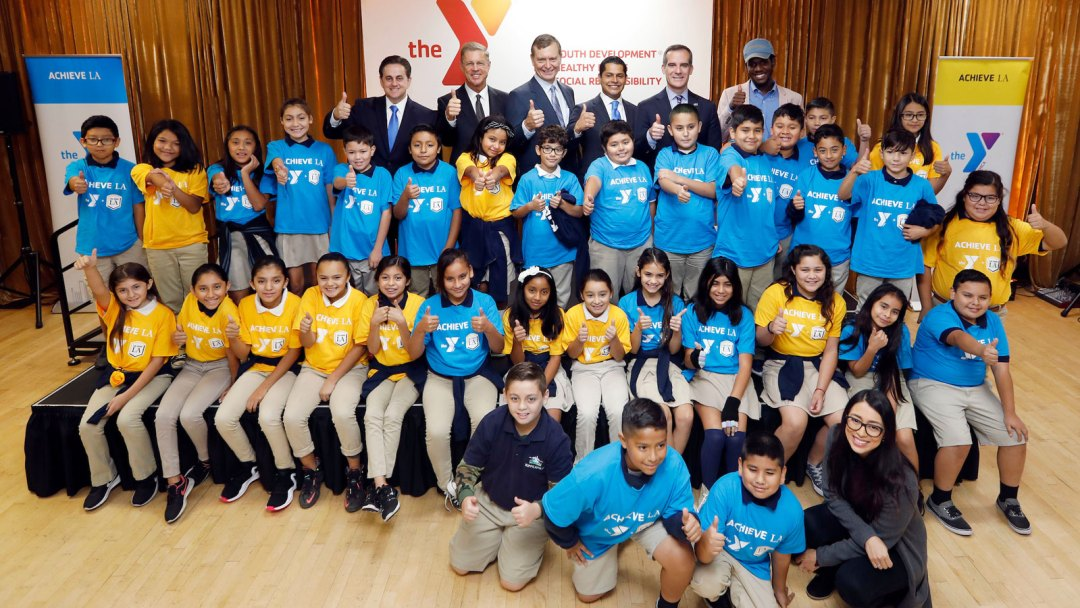 Students with Mayor Eric Garcetti, Assemblymember Miguel Santiago, Cal State LA Executive Vice President Jose A. Gomez, and YMCA of Metropolitan Los Angeles and CEO Alan C. Hostrup.