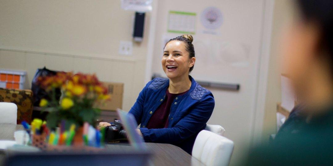 Hattie Mitchell smiling during a Crete Academy staff meeting.