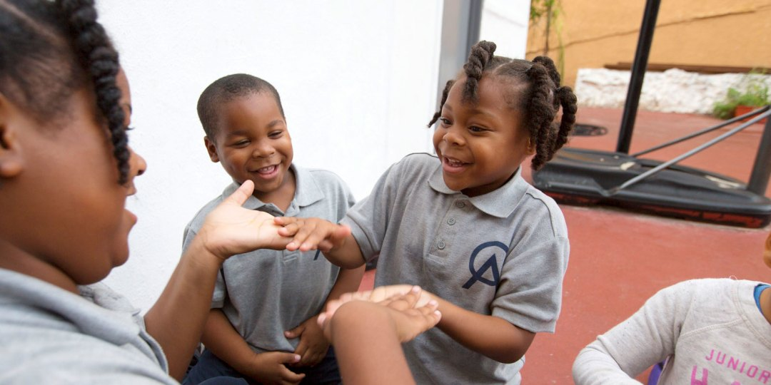 Students playing together during recess at Crete Academy.