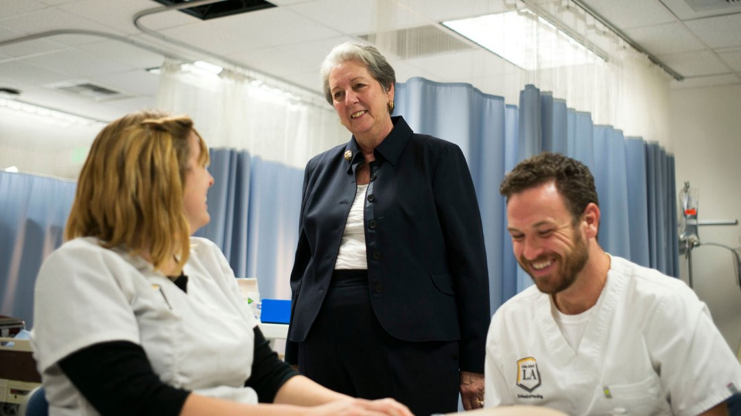 Patricia A. Chin visits with Cal State LA students in the nursing simulation laboratory