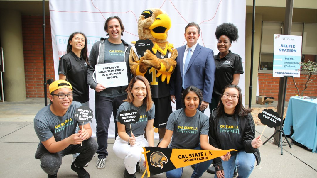Cal State LA students pose for a photo with Everytable founder, Sam Polk, Cal State LA Vice President, Jose Gomez, and Eddie the Eagle.
