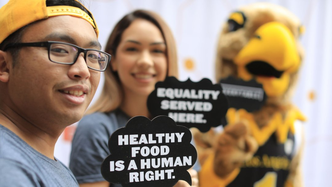"""Cal State LA students with Everytable signage that reads """"Healthy food is a human right"""".."""