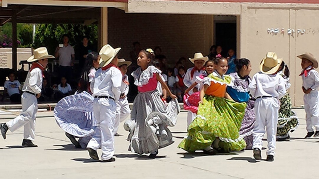 Students dancing traditional mexican dances