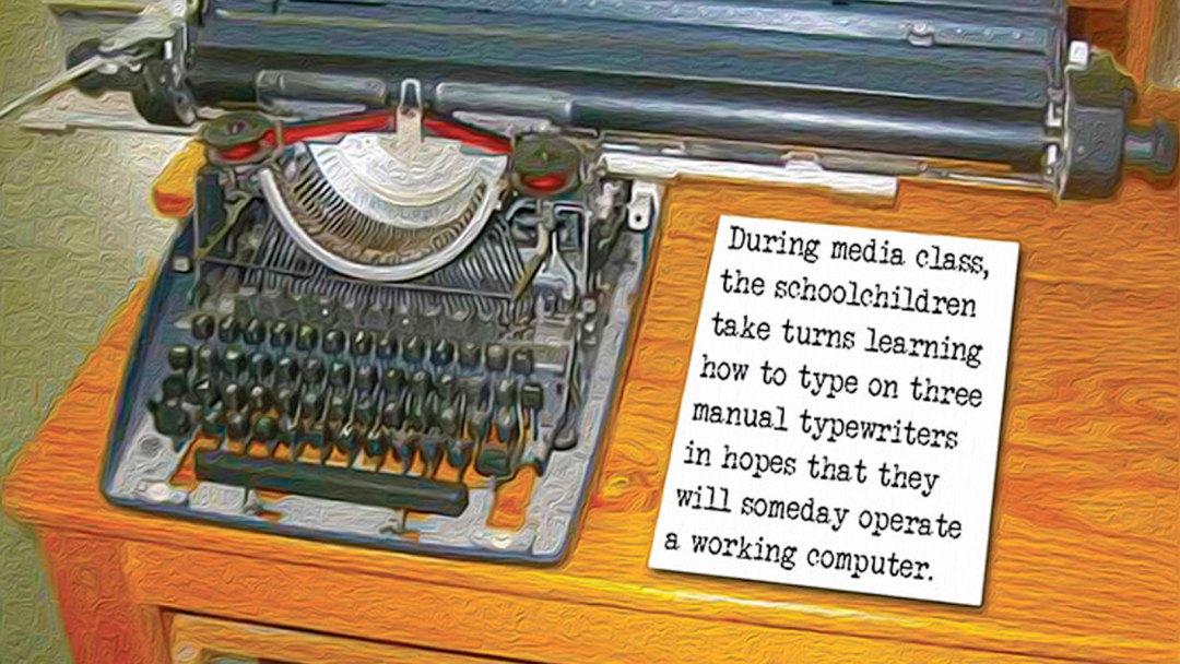 A typewriter on a desk