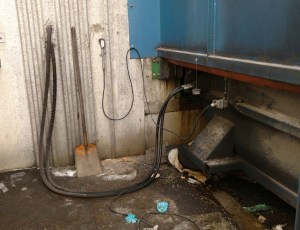 Leaking Hydraulic System On Trash Compactor Identified During Combined SWPPP SPCC Inspection