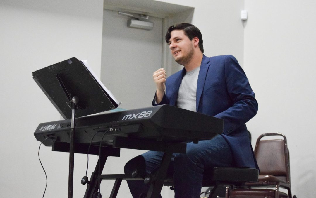 Grad assistant Christopher Stolberg loves teaching music