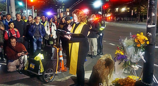 The Rev. Laura Everett leads the Tuesday memorial ceremony in Porter Square. (Photo: Tom Meek)