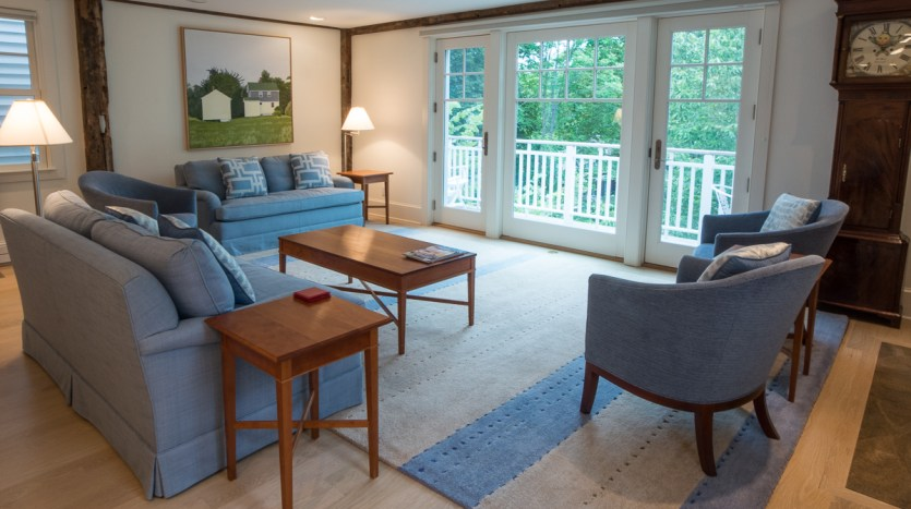 Open living room with doors to porch