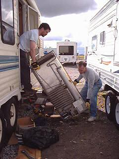 Removing the old fridge from our trailer