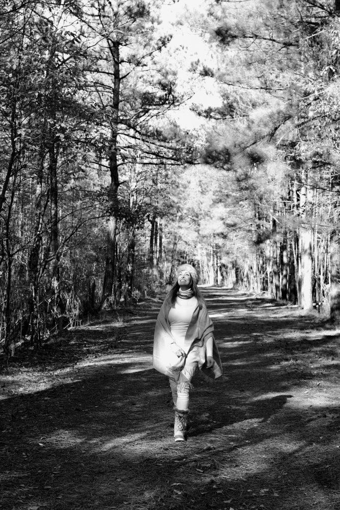 pretty girl walking in winter woods