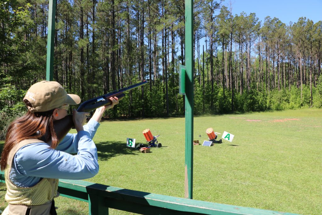 Girl shooting clays