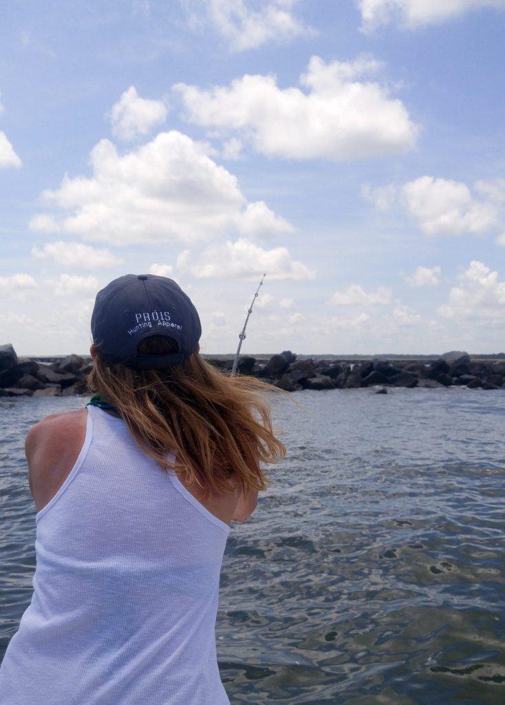 girl fishing the jetties