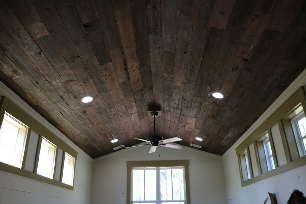 reclaimed warehouse flooring used for ceiling in hunting cabin