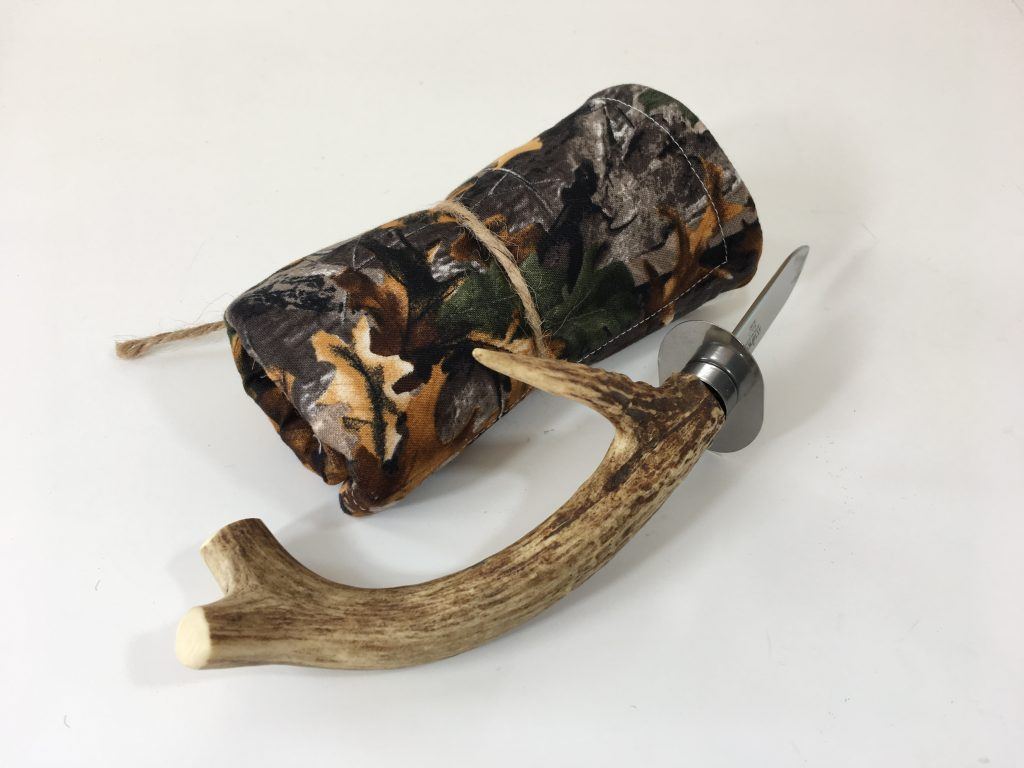 Antler oyster knife and camo napkin