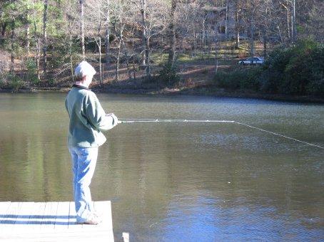 Rhonda fishing for non-existant fish.