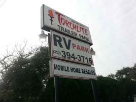 Torchlite RV Park in Clermont Florida Sign