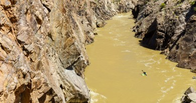 Kate Bowman walled in above Skull in Westwater Canyon on the Colorado River.