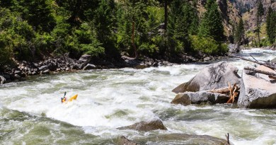 "Egor Voskoboynikov powers through part two of the three-part ""Fall Creek Rapid"" on the South Fork of the Salmon River, Idaho."