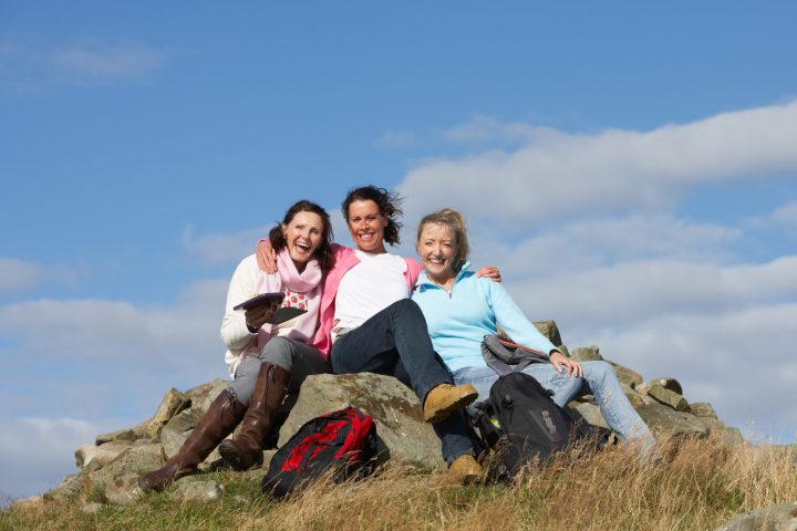 Women enjoying lunch on a hike