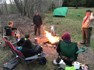 The scouts of Rochelle Park Troop 114 enjoy dinner around a fire at Trimont Scout Camp.