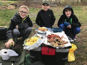 The scouts of rochelle park troop 114 whip up a huge breakfast of eggs, bacon, sausage, and pancakes.