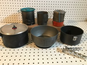 Backpacking Stove Options: Olicamp XTS, Olicamp Space Saver Mug, Snow Peak Mini Solo; Bottom: MSR Quick2 Pot, Optimus Terra HE Pot, MSR Quick2 Mini-pot