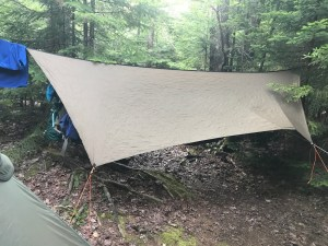 A tarp over a backpacking hammock