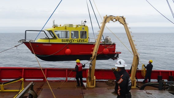 Hydrographers from Fisheries and Oceans Canada work with the Canadian Coast Guard in Arctic waters conducting charting.