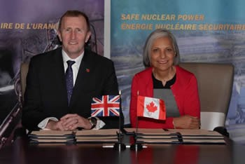 CNSC's President Velshi (representing Canada) and ONR's Mark Foy (Representing the U.K) sign a new administrative arrangement for nuclear cooperation.