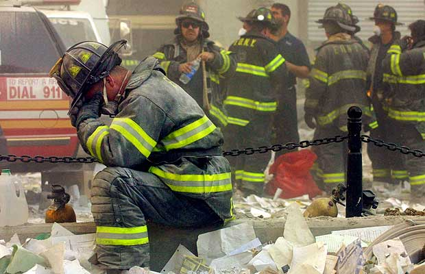 A firefighter breaks down after the World Trade Center buildings collapsed September 11.