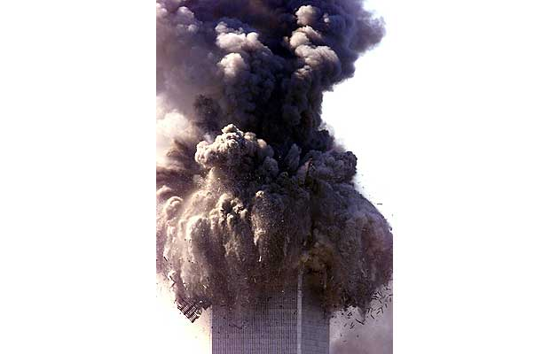 One of the towers of the World Trade Center begins to collapse after suspected terrorist controlled hijacked airliners crashed into both buildings, September 11, 2001.