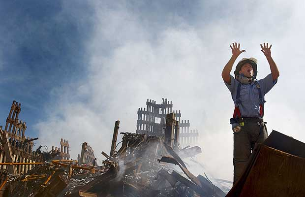 A New York City fireman calls for more rescue workers to make their way into the rubble of the World Trade Center September 14, 2001 days after the September 11, 2001 terrorist attack.
