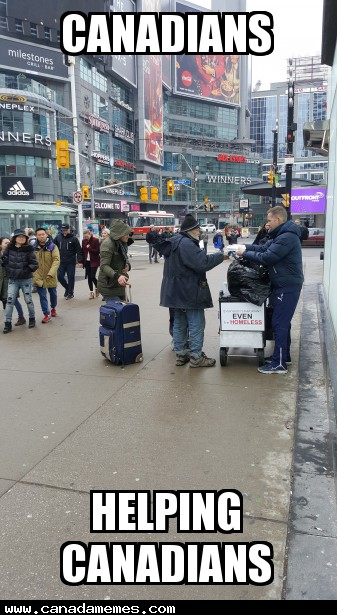 Props to these guys handing out coffee, sandwiches, and fresh socks to the homeless at Dundas Square in downtown Toronto