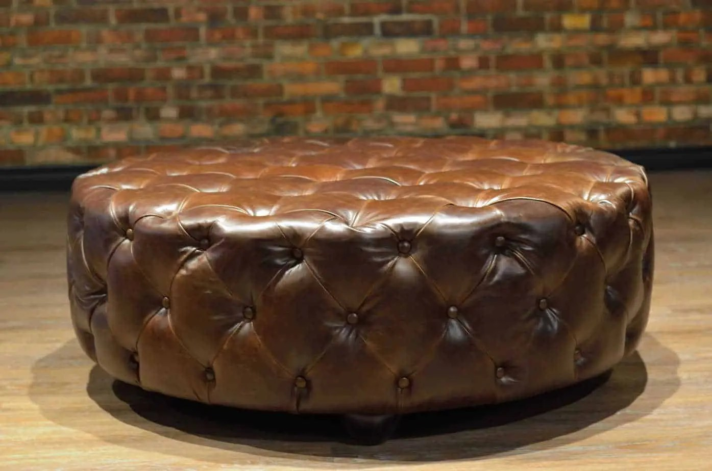 how to fix a sofa spring ashley alenya charcoal reviews the king arthur round leather tufted ottoman collection ...
