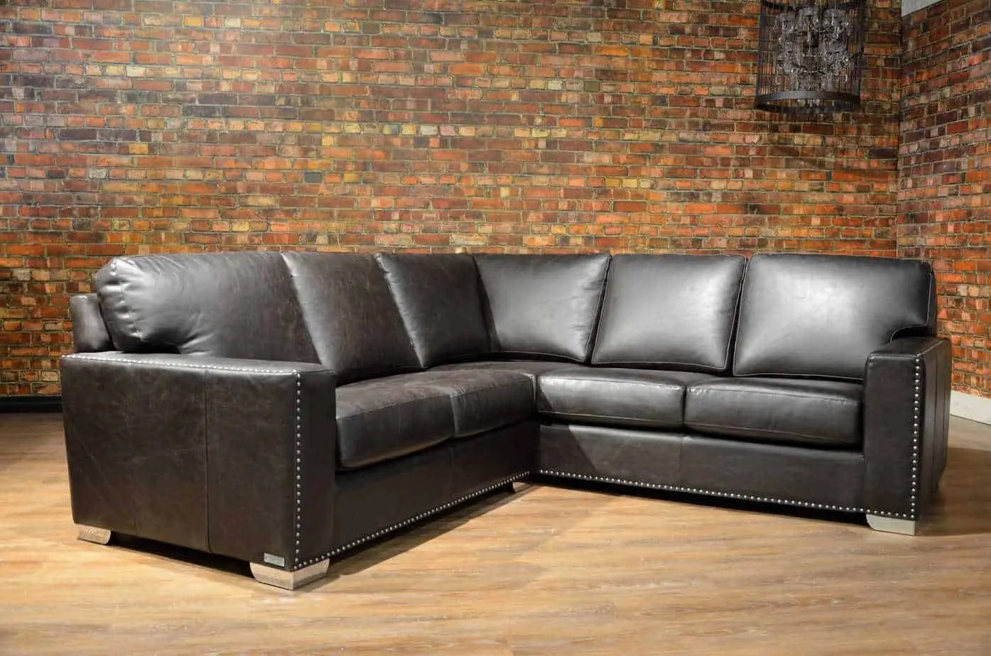 down sofas canada brown sofa blue accents the maxell petite leather sectional 39s boss