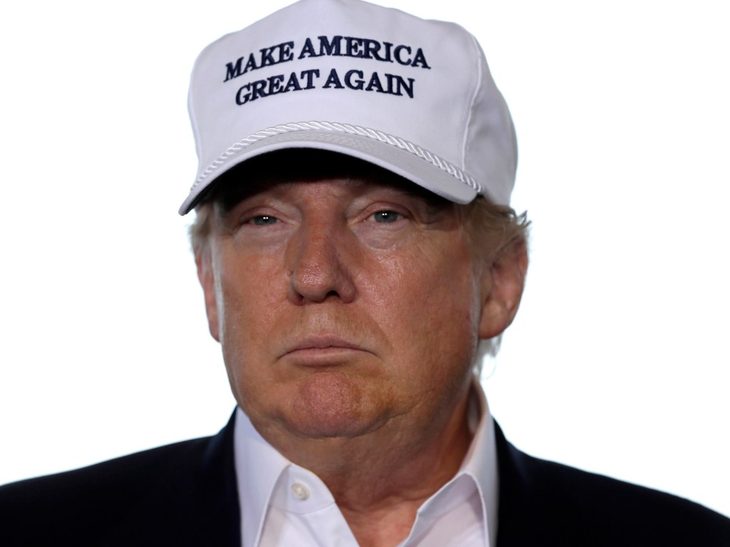 """[A photo of Donald Trump wearing a """"Make America great again"""" hat.]"""