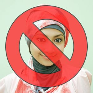 """[A photo of a woman in a hijab, with a red """"no"""" slash overtop]"""