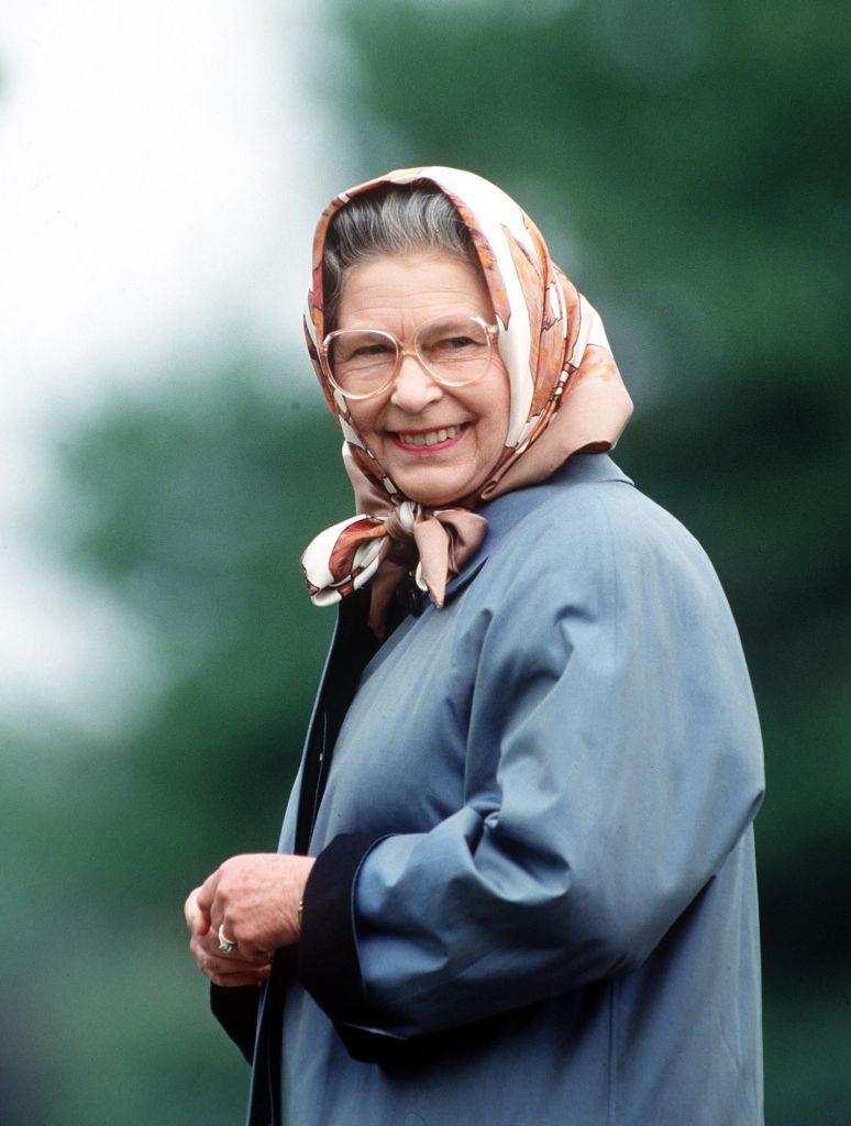 [Photo of Queen Elizabeth II in a headscarf]