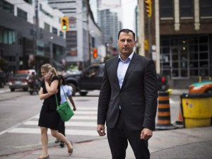 Syrian refugee to Canada Hussein Adb Al Rahim stands for a photo in downtown Toronto on Wednesday, September 9 2015. Hussein came to Canada in 2012 and has been waiting for a hearing for his refugee claim ever since.THE CANADIAN PRESS/Aaron Vincent Elkaim