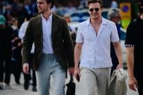 Two men wearing white shirts
